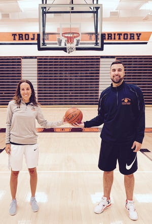 New York Suburban boys' basketball coach Mitch Kemp is shown with his sister, Jess Barley, who has led the Suburban' girls' basketball program for nearly a decade.