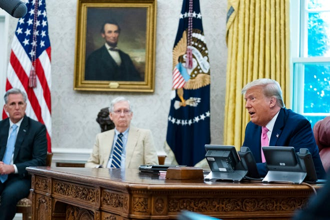 President Donald Trump speaks during a meeting with Senate Majority Leader Mitch McConnell of Ky., and House Minority Leader Kevin McCarthy of Calif., in the Oval Office of the White House, Monday, July 20, 2020, in Washington. (AP Photo/Evan Vucci)