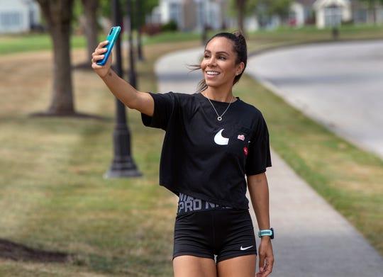 Alysha Flynn makes a cut for a Tiktok video near her home in Spring Garden Township. She has 157,000 followers on fitness Tiktok site @whatrunsyou