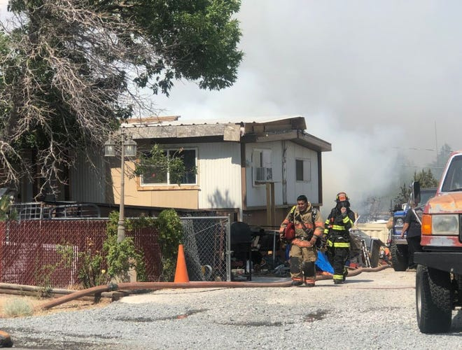 A fire appears to have started in the backyard of a home on Chimney Drive in Sun Valley on July 21, 2020, according to the Washoe County Sheriff's Office.