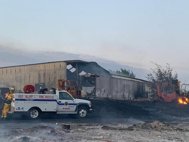 The fire that burned into Red Bluff on Monday damaged a building in town and forced people to evacuate.
