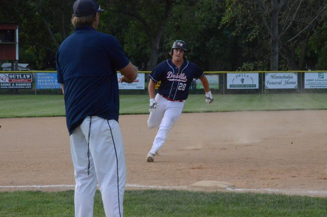 Dell Rapids' Jake Steineke rounds third base as head coach Danny Miller signals to hold up on Monday, July 20 vs. Tea.