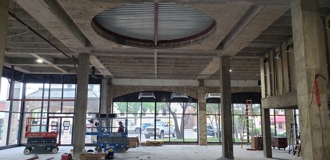 Crews work inside the east side of the BancFirst building in downtown Ardmore. The interior of the building is currently undergoing a complete remodel.
