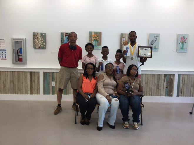 Antwan Witter, top right, is pictured with his children and other family members who recently attended an awards ceremony at the Morris Center for Lowcountry Heritage. Witter won the first Jasper County spoken word contest for a video he made about the death of George Floyd.