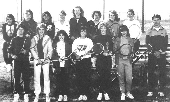 GIRLS TEAM - STATE RUNNERS-UP: Under the leadership of tennis coach Ron Sharp, the Lady Wolves were back in the picture as a state power in the spring of 1984, with a second-place tie for the state title. (l-r) TOP ROW: Angie LaReau, Kim Benton, Maya Balan, Jackie Waddle, Susan Emmenegger, Renee Souleret, & Shauna Lowe . FRONT ROW: Shannon Clark, Susan Dimiceli, Jami Hale, Amy Tallchief, Kristi Sparkman, Andrea Myers, and Coach Sharp.