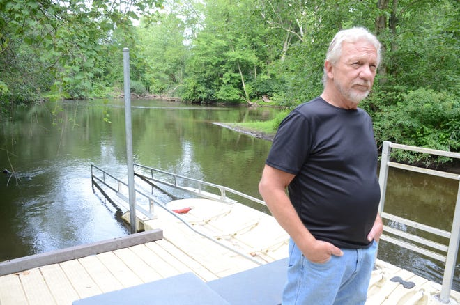 Jesse Jacox believed the Kalamazoo River was ruined by the 2010 oil spill but now says its cleaner than before.  Trace Christenson/The Enquirer