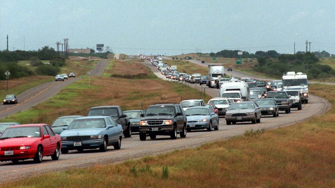 Traffic backs up in the northbound lanes of Interstate 37 Aug. 22, 1999 as residents evacuated Corpus Christi before Hurricane Bret hit.