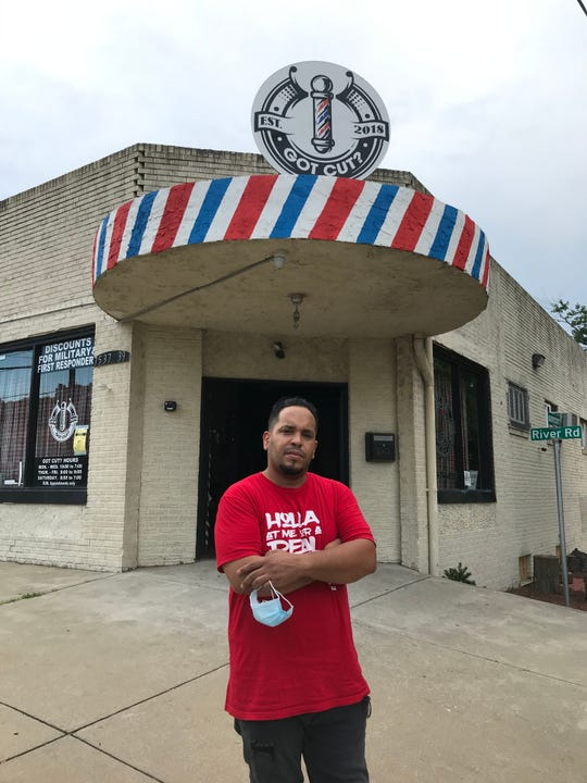 "Jose ""Joey"" Lopez outside his Got Cut? barber shop, shuttered by Gov. Phil Murphy's emergency order closing shops in March to help curb coronavirus pandemic, remain closed after a fire in May at the Pennsauken business."