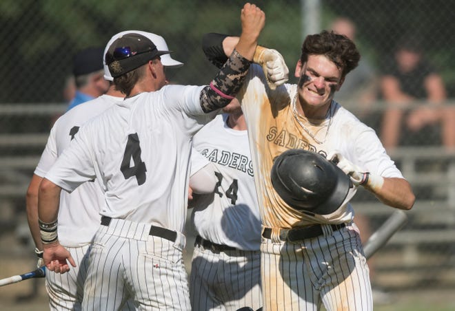 Bishop Eustace/Sader Baseball Club's Chuck Sanzio, right, celebrates with teammates after scoring a run during the Last Dance World Series South baseball game between Bishop Eustace/Sader Baseball Club and Cherokee/Marlton Chiefs played in Owens Park in Williamstown on Tuesday, July 21, 2020.  The Bishop Eustace/Sader Baseball Club defeated Cherokee/Marlton Chiefs, 11-5.
