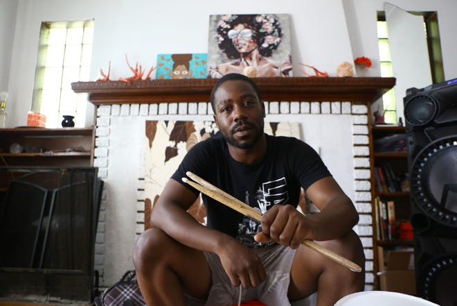 Deon Forrest, 26, of Detroit, the Eastern Market pot discusses his past performances inside of his home in Detroit on Tuesday, July 21, 2020. Forrest who recently gained internet fame when a video was uploaded to facebook showing him drumming on pots in Eastern Market over the weekend.