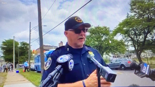 Detroit Police Cmdr. Cmdr. Darin Szilagy briefs journalists after gunman surrenders.