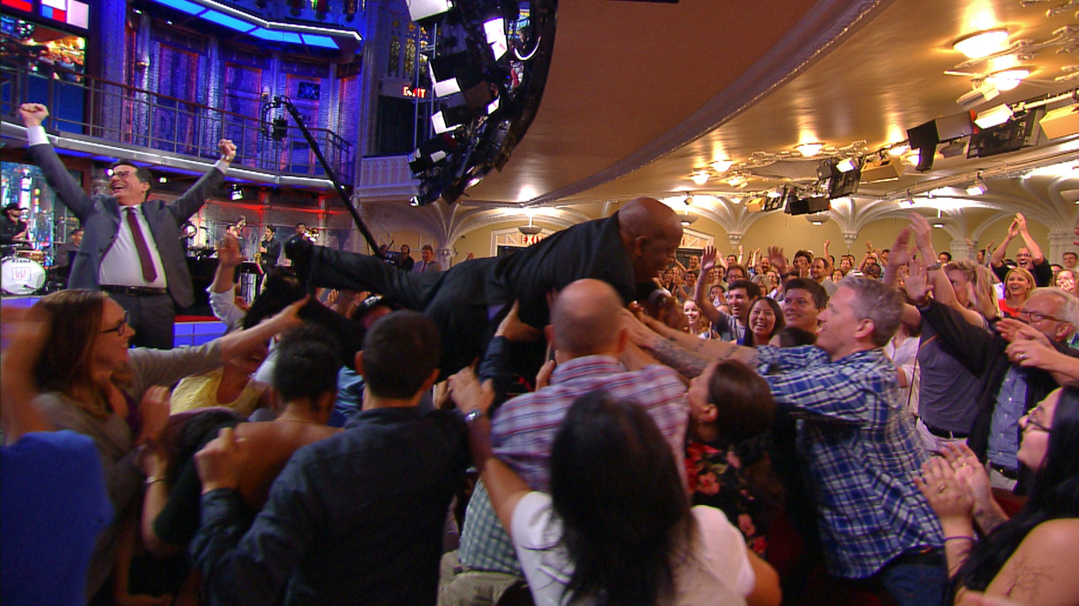 The Late Show with Stephen Colbert , Stephen Colbert , left, celebrates as Rep. John Lewis audience surfs during an August 30, 2016, taping in New York.