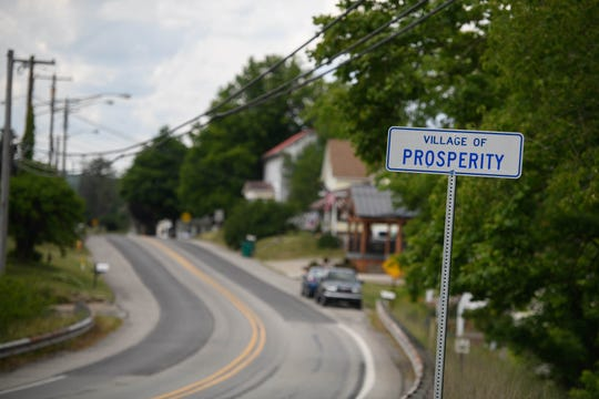 The sign for the village of Prosperity sits along state Route 18.