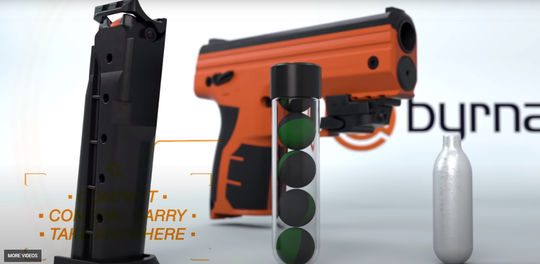 A screenshot from a promotional video of the Byrna HD launcher, magazine, ammunition and CO2 canister.