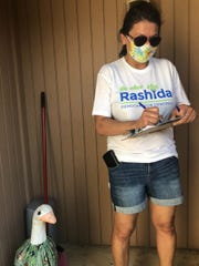 Amid the pandemic, U.S. Rep. Rashida Tlaib, D-Detroit, has resumed in-person campaigning and knocking doors in her bid for a second term, pictured on the campaign trail in Westland last month.