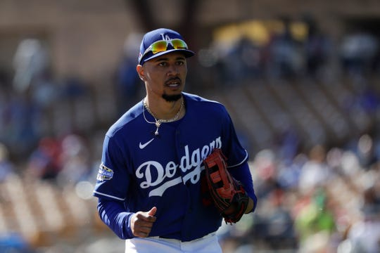 Mookie Betts and the Los Angeles Dodgers struck baseball's first big-money deal since the coronavirus pandemic decimated the sport's economics, a $365 million, 12-year contract on Wednesday through 2032 that removes the top offensive player from next offseason's free-agent class.