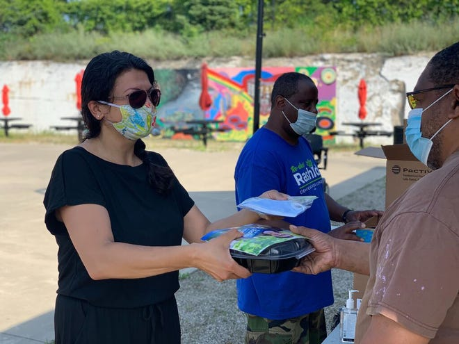 Amid the pandemic, U.S. Rep. Rashida Tlaib, D-Detroit, has resumed in-person campaigning and knocking doors in her bid for a second term, here at a food distribution event at Piquette Square in Detroit.