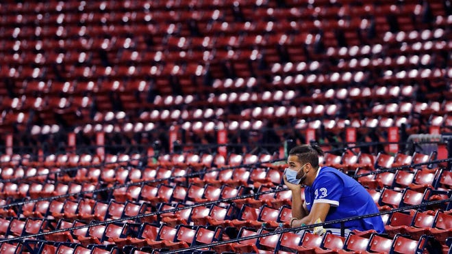 Toronto Blue Jays outfielder Lourdes Gurriel Jr. watches from the empty stands during the fourth inning of an exhibition baseball game against the Boston Red Sox, Tuesday, July 21, 2020, at Fenway Park in Boston. (AP Photo/Charles Krupa)