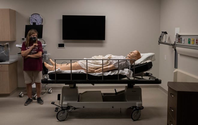 A mannequin lies in a hospital bed as Susan Ihlenfeldt, a nursing faculty member, discusses the teaching applications of a simulation room in the new Grays Peak building at Front Range Community College in Fort Collins, Colo. on Wednesday, July 22, 2020.