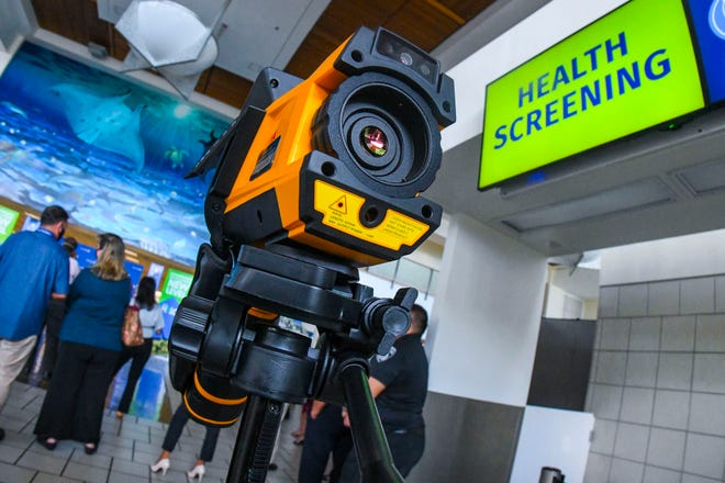 An infrared thermal camera used to measure the body temperature of passengers and guests entering the ticket lobby at the A.B. Won Pat International Airport is shown in this July 22 file photo.
