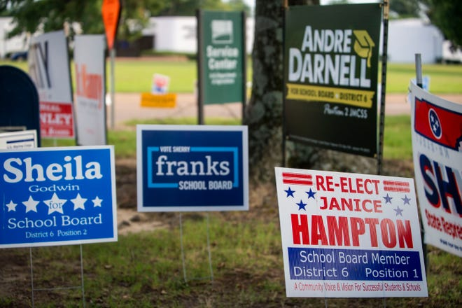 School board candidates' campaign signs sit outside the Madison County Election Commission on Tuesday.