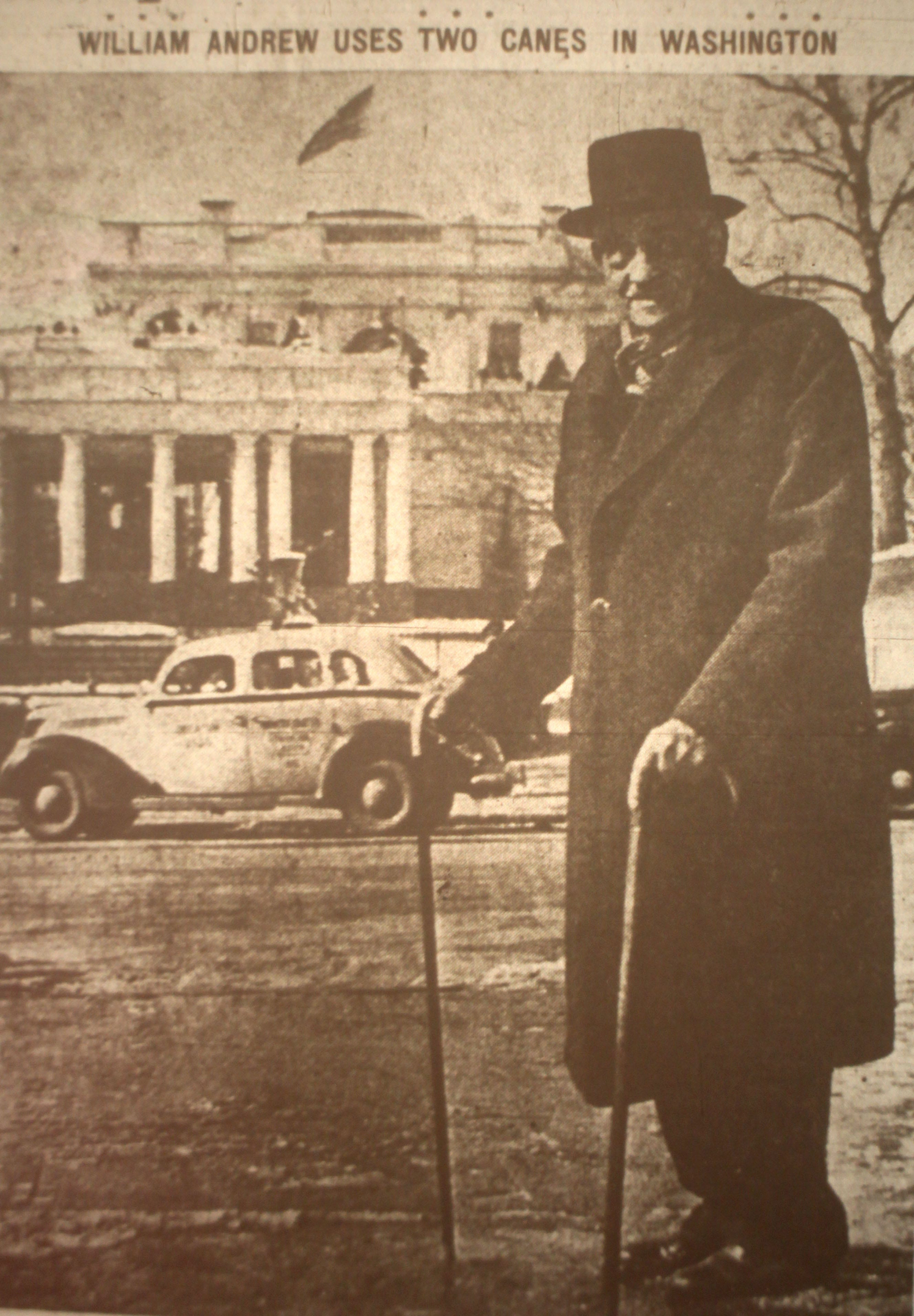 William Andrew Johnson, a former slave of President Andrew Johnson, in front of the White House in Washington, DC in February 1937.  In his right hand he holds the cane presented to him by President Frankiln Roosevelt during a visit to the White House. Johnson was freed along with 10 other slaves in 1863.