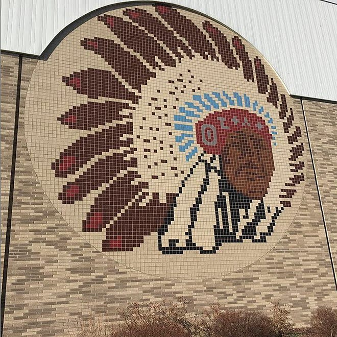 A mural on the side of Twin Lakes Senior High School in Monticello depicts the schools mascot, the Twin Lakes Indians.