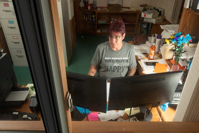 Town of Nokomis Clerk Wendy Smith works on mailing out absentee ballots for the upcoming primary election early in the evening July 14 at the Town Hall in southern Oneida County.