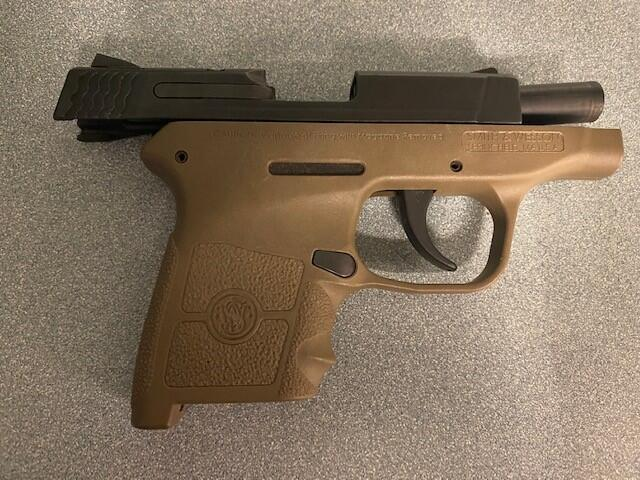 TSA officers found this handgun in a passenger's carry-on bag at a security checkpoint. The man told sheriff's deputies that he forgot the gun was in the bag.