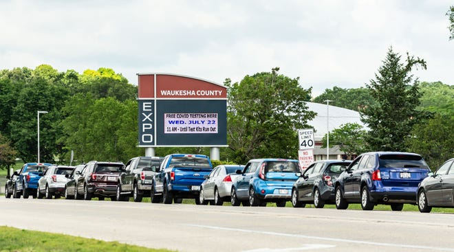 A line forms outside the Waukesha County Expo Center on Wednesday, July 22, prior to the opening of a free COVID-19 drive-thru testing site. The Wisconsin National Guard will conduct similar testing events through Dec. 9. Waukesha County is also partnering with health care professionals to make daily testing possible.