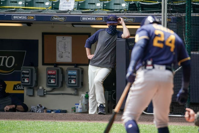 Brewers manager Craig Counsell looks on during an intrasquad game Monday at Miller Park. The Brewers open their regular season Friday against the Cubs.