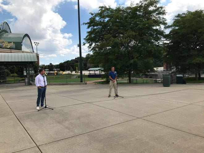Brewers broadcasters Brian Anderson and Jeff Levering meet with reporters outside Miller Park on July 22, 2020.