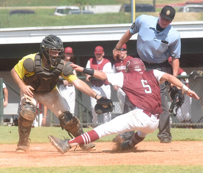 Texarkana's Nate Moore (5) eludes the tag of Lockeroom catcher Carter Bagwell during the Razorbacks' 8-4 victory Tuesday at Bryant.