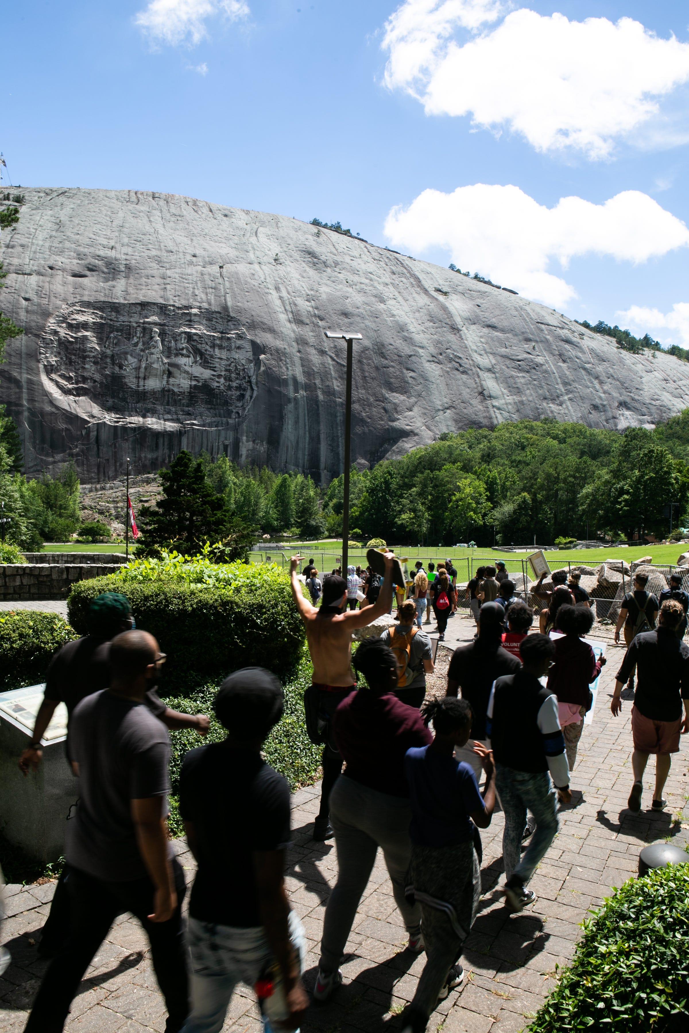 STONE MOUNTAIN, GA - JUNE 16: Black Lives Matter protesters lead march in Stone Mountain Park to the Confederate carving etched into the stone side of the mountain on June 16, 2020 in Stone Mountain, Georgia. The march is to protest confederate monuments and recent police shootings.  (Photo by Jessica McGowan/Getty Images)