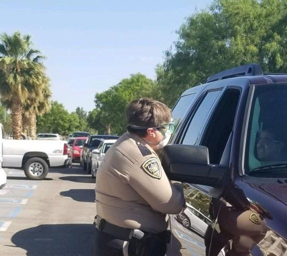 Doña Ana County Sheriff Kim Stewart gives away masks to the community at the main station in May.