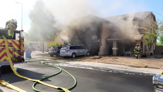 Buckeye police Assistant Chief Bob Sanders and fire Deputy Chief Dave Dubois responded to a call for a house fire on Tuesday morning and rescued two children from the home near Rainbow Road and Sundance Parkway.
