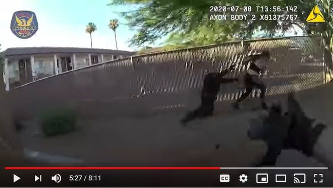 A screenshot of a video shows body-camera footage of Phoenix police attempting to arrest Jovana Kelsey McCreary in Phoenix on July 8. Police say after struggling with McCreary, she pulled a handgun from her waist and fired at officers, narrowly missing them. Two officers returned fire and struck McCreary twice.
