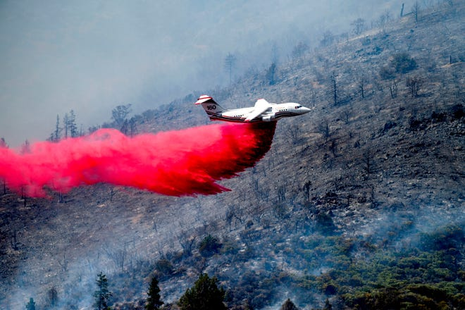 An air tanker drops retardant as the the Badger Fire burns near Yreka on Sunday, July 19, 2020. Several wildfires sparked Sunday throughout Northern California as portions of the region remain under a heat advisory.