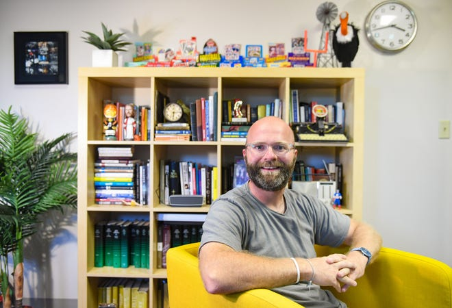 Pastor Adam Weber sits in his office on Wednesday, July 22, at Embrace Church in Sioux Falls.