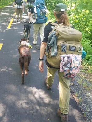 Helyn Stowe rucks with her dog, Astro.