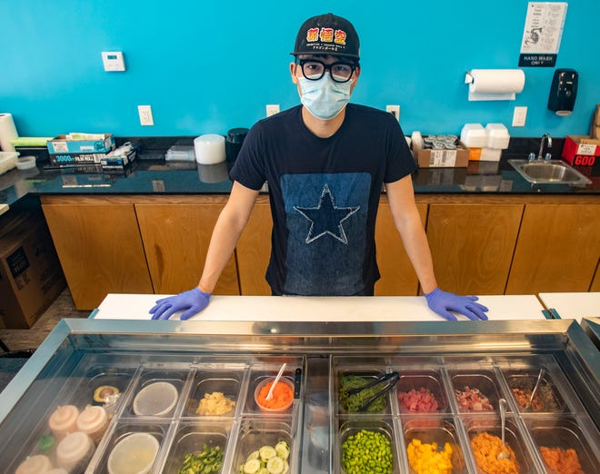 Ping Lin is the owner of Kami Poke & Korean Kitchen, off of Apalachee Parkway.