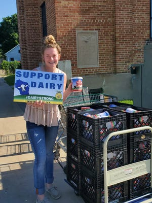 Elizabeth Katzman raised over $10,000 from the sale of yard signs in an effort to rally support for the state's dairy farmers. Proceeds from sign sales were poured into purchasing dairy products for donations.