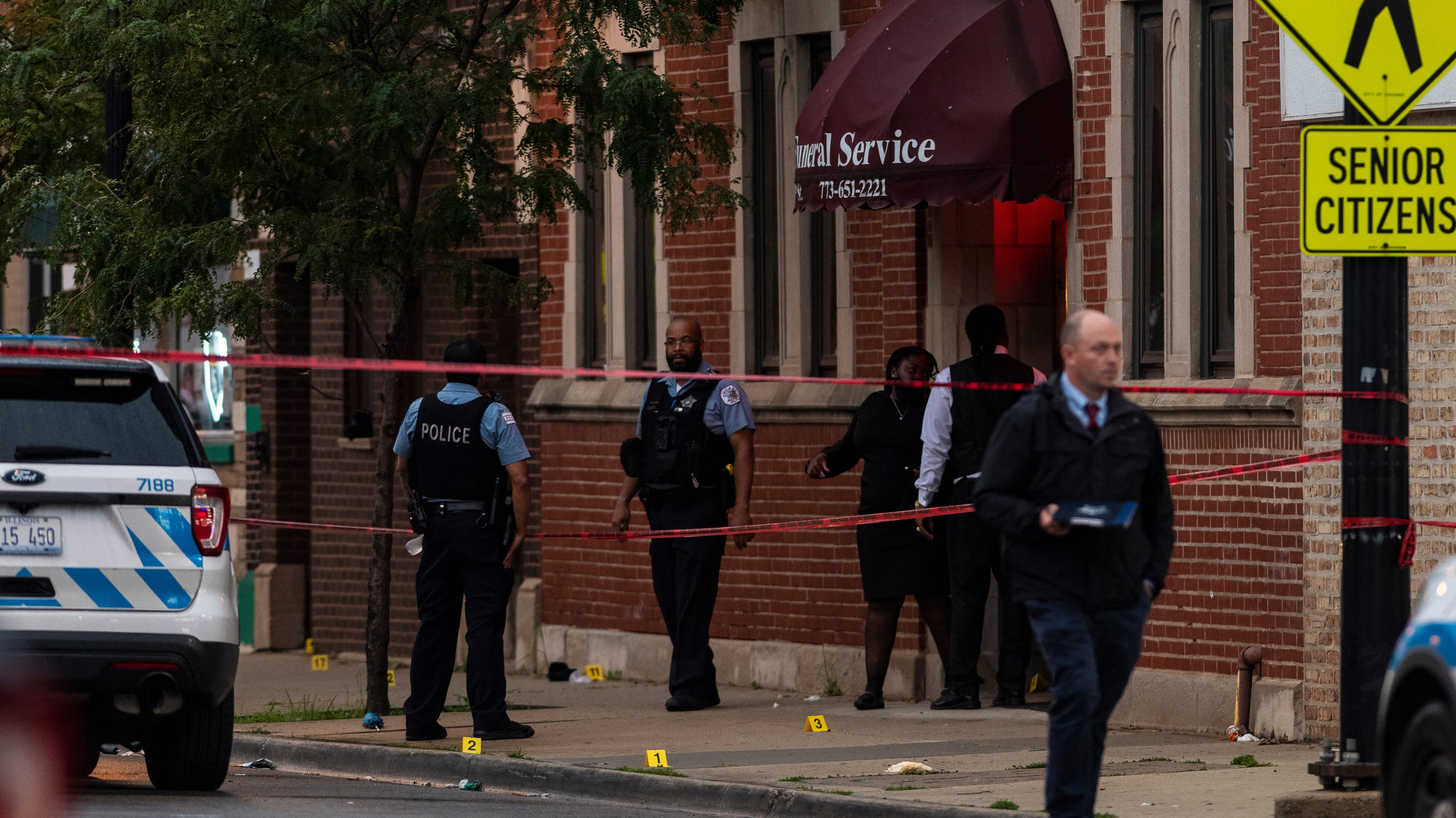 Police: 14 hospitalized after drive-by shoot-out at Chicago funeral, 1 'person of interest' in custody