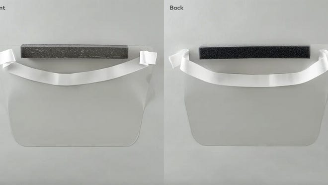 The front and back of the plastic face shields.