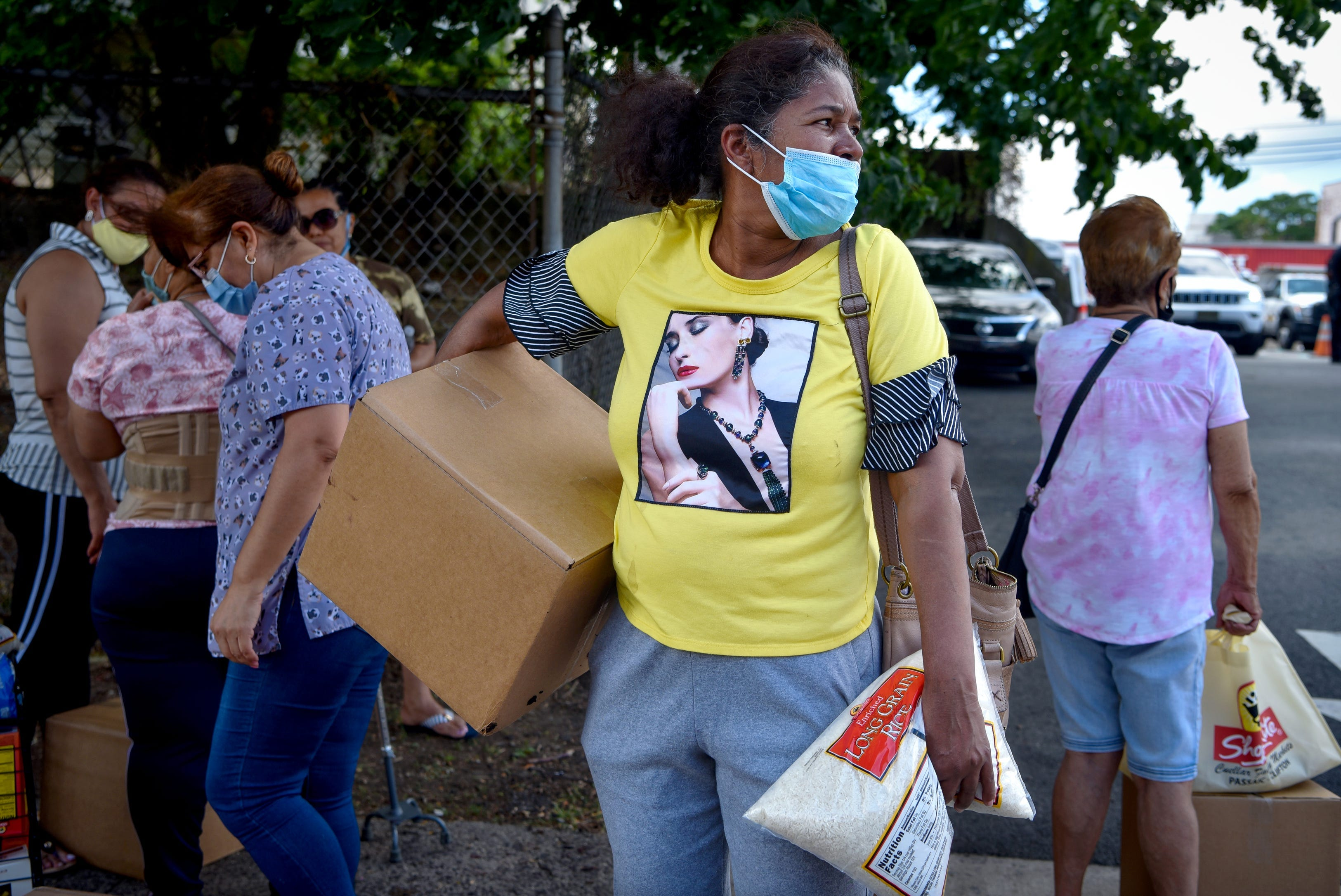 Residents pick up food boxes in Passaic, New Jersey, on June 29 after the county secured more than $87 million in coronavirus relief from the federal government.