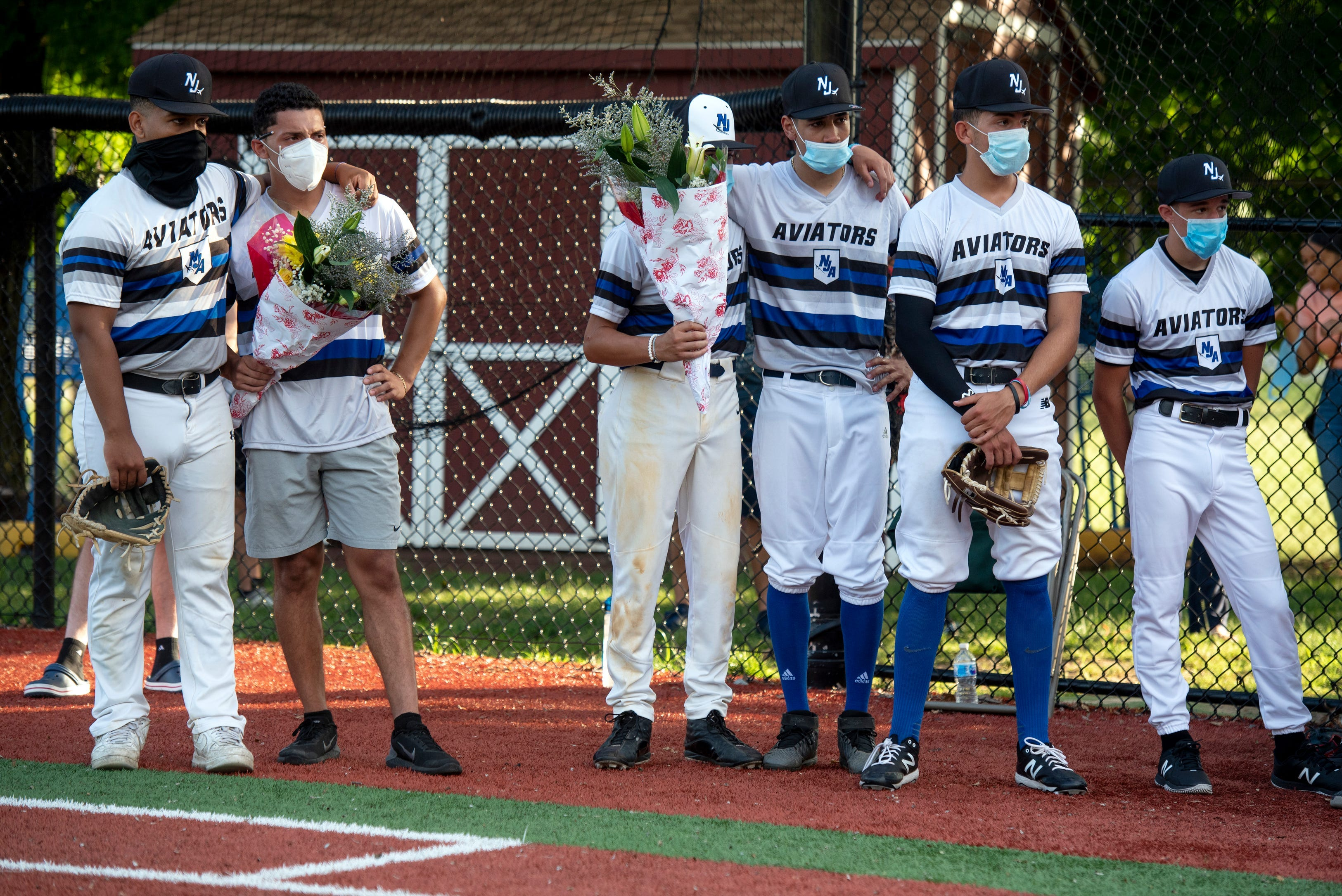 Baseball coach and Don Bosco Preparatory High School alum Ben Luderer is honored before a tournament game in Ramsey, New Jersey.