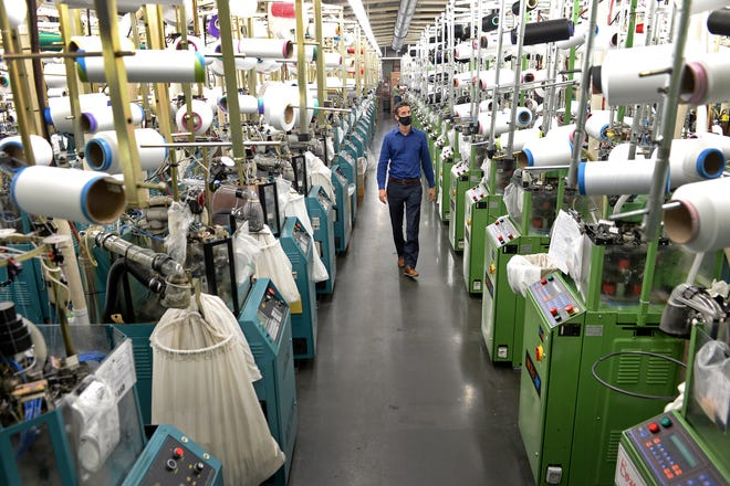 ASHEBORO, NORTH CAROLINA - Jordan Schindler, Founder and CEO of Nufabrx, walks through a row of machines producing Theramasks at the Bossong Medical plant in Asheboro, N.C. on Thursday, July 16, 2020. Jeff Siner / The Charlotte Observer / North Carolina News Collaborative