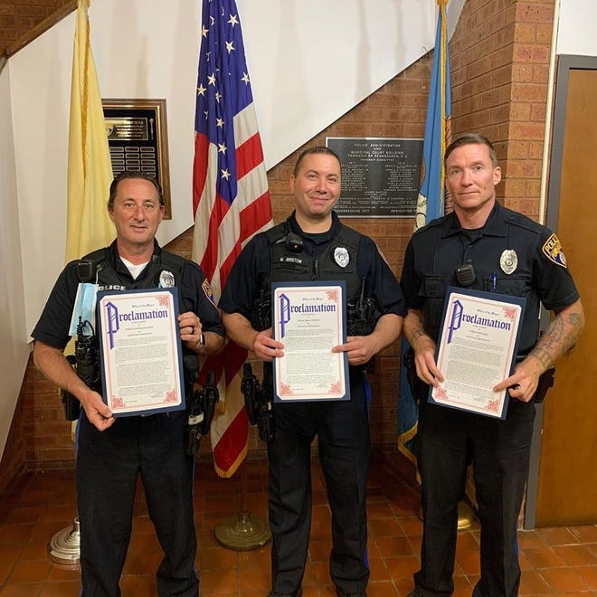 Pennsauken Township issued proclamations to police, emergency medical technicians and firefighters for helping to revive and save the life of a boy who drowned  in a swimming pool after Memorial Day week. Pictured from left are Christopher Jones,  Marco Bristow and Robert Carey.