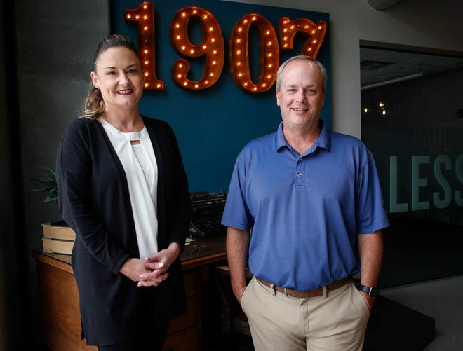 Business partners Tom Flynn and Jess Held pose for a photo at Lessing-Flynn in Des Moines on Tuesday, July 21, 2020.