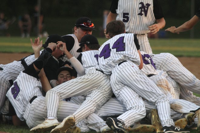 Norwalk players react to advancing to the state tournament. Norwalk beat Centerville 4-1 at home on July 22 to earn a Class 3A state tournament berth.